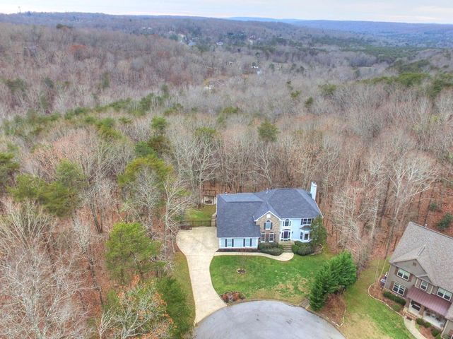 Welcome to 2901 Blue Teal Lane in the popular Fox Run neighborhood on Signal Mountain. This beautiful, move-in ready home is situated on 1.28 acres at the end of a cul de sac. If you are looking for a large home with privacy then this is it! The main level features a welcoming foyer, a formal living room or office, formal dining room, large, bright kitchen with room for a breakfast table, half bath, laundry room, family room with built-ins and a fireplace. There are four bedrooms upstairs including 2 expansive master suites and three full bathrooms. The finished basement is currently being used as a mother-in-law suite with a bedroom, full bathroom and bonus room with a kitchenette. You will love entertaining in the private, fenced backyard with custom fire pit, arbor and swings, hot tub, screened porch and open porch. The current homeowners have even created a 1/3 mile walking trail along the property. The wood floors have been refinished, new carpet and the exterior of the home has been painted. PLEASE SEE NEW EXTERIOR PHOTOS!!!