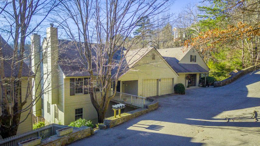 Discover this brow-side condo in the sought after Stonedge Village atop Lookout Mountain ,Tn. The scenic and long range views are gorgeous. The flexible floor plan includes 5 bedrooms and 4 full baths. The den/family room has a stacked stone fireplace with gas logs.The sunroom off the kitchen is filled with natural light.Two outdoor decks add to the enjoyment. The floors have been refinished, it comes with the furniture ! Two car attached garage. Living on Lookout is magical! Nearby restaurant, spa, grocery, town commons , churches and award winning schools add to the serene lifestyle. are part of this fully furnished condo and the furniture comes with it!