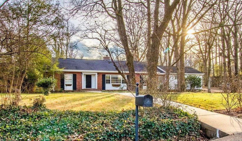 This classic brick and clapboard, 3050 square foot cottage nestles on a sprawling lot in the heart of Lookout Mountain. This home is short stroll from the town center, parks, and dining on historic Scenic Hwy. This is the perfect spot for a family seeking a warm welcoming home in a community of good friends and great schools. Bright and inviting living spaces for your family to spread out, complete with a cozy fireplace and a sunny keeping room, full of windows bringing the private and beautiful garden inside. Four spacious bedrooms and 3.5 bathrooms,  with the master in a private wing. All of this surrounding a storybook kitchen with a whimsical butler's pantry connecting the entertaining spaces. Call TODAY for your private tour.