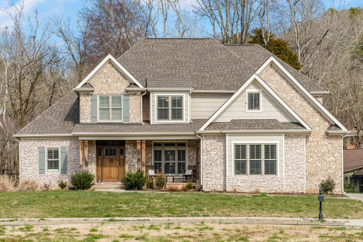 This luxurious dream home welcome's you to The Canyons Subdivision where community ponds, pool, playground, and sidewalks await. Location is convenient to Hixson, Downtown Chattanooga, and 153 Hwy leading straight to I-75 and the Hamilton Place area. The stone and brick exterior present you with easy low maintenance. As you walk through the wood front door ceilings soar with a lantern chandelier in the foyer and every space is filled with natural light and details. The dark wood floors offer great contrast to the white trim. The living room has a marvelous stone fireplace reaching the coffered ceiling with windows on either side featuring plantation shutters including access to the back porch. The kitchen features granite countertops, white custom cabinets, subway tile backsplash, all stainless steel appliances, and large matching island which offers extra dining space. The breakfast nook features a 3 sided built-in bench by the windows. The separate formal dining room highlights wainscoting reaching for the ceiling and a wide pendant lantern chandelier. The spacious master is on the main level offering trey ceiling, en-suite with custom cabinetry, double vanities, garden tub next to built-in shelving, separate tiled shower, and walk-in-closet. The  main level also offers an additional bedroom and full bath, and laundry & mud room. Upstairs you will find 2 more additional bedrooms with walk-in-closets, spacious full bath, bonus room, and a den. Love at first sight exists here! Schedule a private tour today!