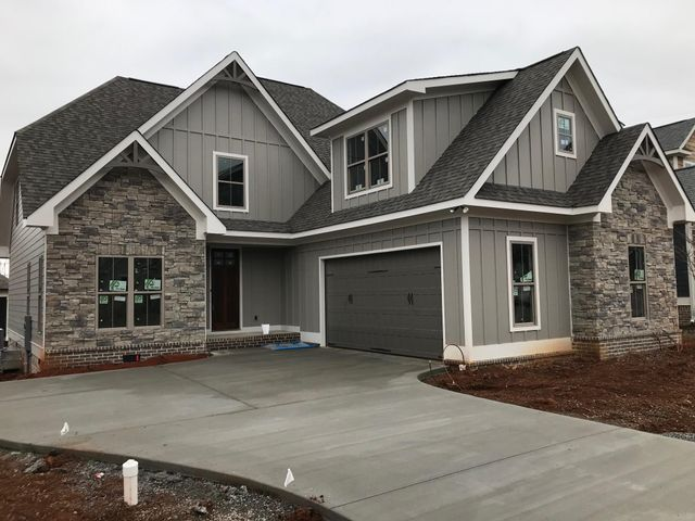 This beautiful new construction home offers a wonderful open floorplan with attention to detail. Custom cabinetry, modern fixtures, large granite island, and stainless appliances round out the kitchen.  The master suite is on the main floor, with 3 bedrooms upstairs, or make that oversized bedroom your bonus room for play, crafting or entertainment.   Prairie Pass offers a Clubhouse, Swimming Pool, sidewalks, streetlights, and is zoned for Apison/East Hamilton schools!  Call today for your private tour!Updated photo's 2/3