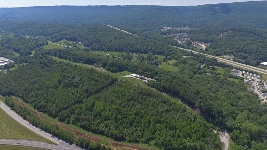 Attention home builders! Development opportunity in central business district of Hixson.  Over 21+/- acres of scenic hilltop offering northern views of the Tennessee Valley and surrounding mountains. Easy access to all Hixson shopping and retail along highway TN153. Nearby US 27 is only about a 10 minute drive to the Chattanooga Riverfront. Contact agent for more details.
