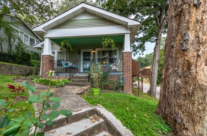 Condition, Location and Price- This home has it all and is move in ready! This charming 3 bedroom, 1.5 bath home is located in the desirable North Chattanooga Community and is zoned for the Normal Park schools. This is within minutes to all of the shops, restaurants and parks of the North Shore and Downtown Chattanooga. The covered front porch is welcoming. Step inside to beautiful hardwood floors throughout and a open floor plan. The living room with gas fireplace will be the gathering spot. The dining room is perfect for entertaining. The kitchen has plenty of cabinet and counter space. The master bedroom is spacious. There are 2 additional bedrooms ,full bath and half bath on the main level. This home has been well maintained and is ready for new owners. Make your appointment for your private showing today. SPECIAL FINANCING AVAILABLE ON THIS HOME COULD SAVE YOU $4000.