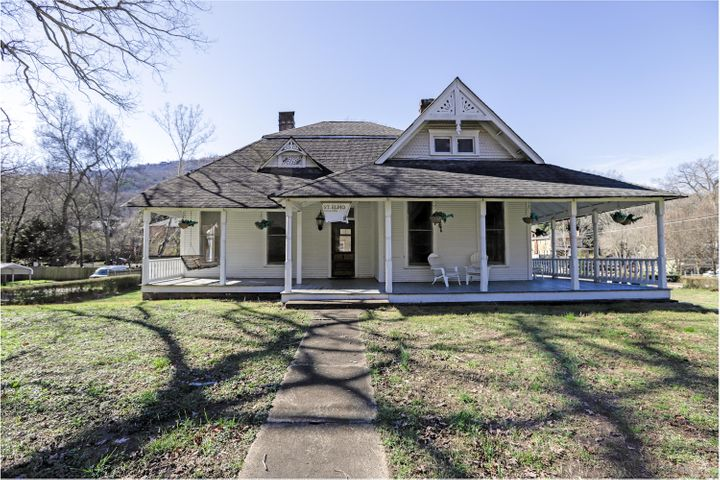 Historical St Elmo .61 acres. Southern charm architecture.  High ceilings, hardwood floors and staircase . Level property. Covered porch...within walking distance to restaurants and shopping.  The perfect Airbnb scenario if something like that is of interest to you.  Must see to appreciate.