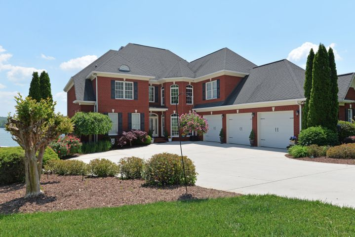 Just in time for summer! If you are looking for a lake home with breathtaking views of the main channel from almost every room in the house, an ideal place to entertain, an open floor plan, the master on the main, a gourmet kitchen, a daylight finished basement, fantastic storage, 3 bay heated and cooled garage, a Gunite heated pool and hot tub, a double level dock with 2 boat lifts and 4 jet ski lifts--just to start--then we have the perfect house for you! Conveniently located just 25 minutes from downtown Chattanooga via Highway 27 or Hixson Pike, this all brick, 5 bedroom, 4 full and 2 half bath home has something for everyone. The seller has just finished many improvements, including installing new lighting over the breakfast bar, freshly painting much of the interior, painting the exterior shutters, new main level deck frame and composite decking, new top level dock decking and stairs, and flashing and caulking the windows. You will love the interesting architectural details and beautiful finishes throughout this move-in ready house. The kitchen is open to the spacious breakfast room and to the great room with a wall of windows highlighting the view and allowing great natural lighting. The great room also has a gas fireplace with built-ins on either side and access to the main level composite deck that spans the back of the house - perfect for outdoor dining or curling up with a book away from the activity at the pool. The kitchen has granite counter tops and tile back splash, a raised breakfast bar with pendant lighting, custom cabinets with under-cabinet lighting, a center island with prep sink, built-in cabinet-style Subzero refrigerator, 2 Bosch dishwashers, Dacor gas cook top, over-sized convection oven and separate wall oven and Bosch microwave, large Dacor warming drawer, a walk-in pantry, and access to the formal dining room, laundry room, garage, and basement. The master suite is on the other side of this level and has a cork floor, gas fireplace, access to the rear deck with views of stunning sunrises over the lake, as well as the master bath with double granite vanity, jetted tub, separate shower with tile and glass surround and a walk-in closet with organizer system. The second story has a handsome office with coffered ceiling, wood paneled walls and built-in shelving, and a spacious media room has tiered theater seating for ten or more, a refreshment center with wet bar, granite counter, built-in refrigerator, and large walk-out finished storage which is currently being used as a play room. There are 3 additional bedrooms, all with walk-in closets and two shared baths with granite vanities and large jetted tub/shower combos. The lower level has 10' ceilings and crown molding, including the large rec/family room with access to the rear covered patio and pool area and is open to a full 2nd kitchen which also has granite counter tops and stainless steel appliances, as well as a walk-in pantry with an extra stainless steel work station and commercial hood and plumbed for a large ice machine, another storage room currently set up as wine cellar, a utility room with all of the mechanicals and a 2nd laundry facility, as well as the 5th bedroom, another full bath and a large exercise room. After purchasing the home, the sellers replaced the existing pool with a beautiful Gunite heated pool with decorative fountains and a sunbathing platform, hot tub, slate surround, and a glass wall for a safe, but unencumbered, view of the lake. They also updated the custom, whole house smart home system with alarm upgrade, automation, and SONOS. A custom masonry combination outdoor fireplace and full size traditional box smoker add to the festive atmosphere, and there is also a convenient outside half bath and shower. The two story dock will appeal to water sports enthusiasts and the top deck offers a beautiful spot to soak up the sun and fun, and then relish beautiful sunsets. Some additional improvements include: new high efficiency HVAC system in 2015; dock lift upgraded in 2012 to heavier duty to accommodate a larger boat (10'x30' slip); new great room windows in 2012, new trim in dining room and hall, smart home wiring installed in 2012 and updated in 2017. All of this, and it is located on a cul-de-sac street with very little traffic and great neighbors. Who needs to go away on vacation when you can live in such a gorgeous home all year round! Please call for more information and your private showing today! Information is deemed reliable but not guaranteed. Buyer to verify any and all information they deem important.