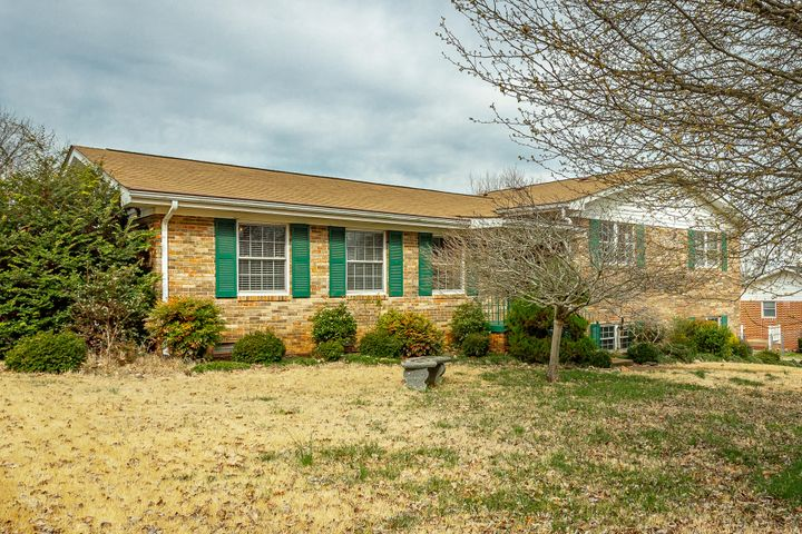 The best of all worlds...less than 2 miles to the Hamilton Place area and all it has to offer, yet you only pay county taxes, not city!  So convenient to I-75, both North and South.  Great family home.  Large family room w fireplace and In-ground pool.  Sellers removed the wall between the living room and kitchen for a delightful open flow for entertaining.  Lots of updating completed and all wallpaper removed.  Community pool also available for annual fee of appx $200/yr.  Please verify, if interested. There is a room in basement that is mostly finished that could be used for office or exercise room.