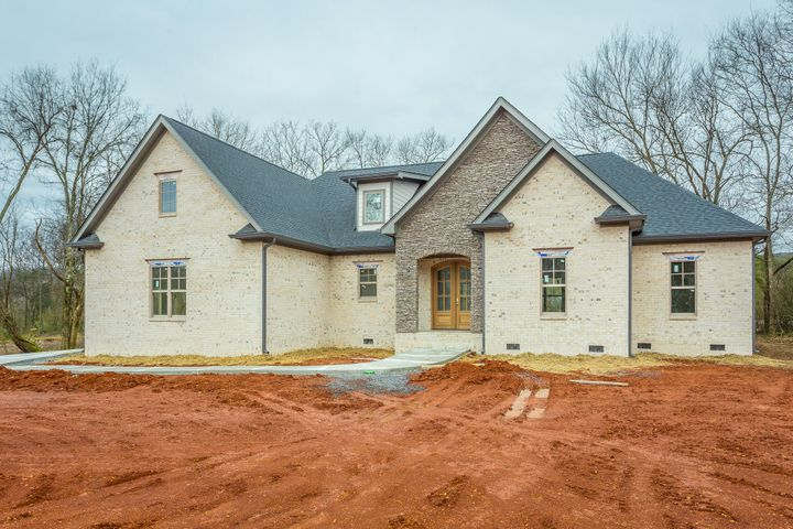 """Single-level luxury homes on acreage lots are now available in The Meadows at Falling Water. Convenient location off Roberts Mill Road just before the ascent up Signal Mountain. Enjoy the scenic mountain views just outside your door! Limited to only 4 acreage homesites in this private community, only 2 homes remain! This desirable one-level home features 3 Bedrooms, Office (4th Bedroom) and 2.5 Baths on the main level. Above the 3 car garage is a Bonus/Flex and Full Bath. Mudroom, oversized laundry, a pantry room (yes, it's a room!), open concept living plan, large kitchen island and covered back porch measuring 18x12. The Master Suite is a retreat, separated from the main living area and offering a 14x17 Bedroom with generously-sized Bath! Separate vanities, soaking tub, tiled shower, water closet and a 16x7'4"""" walk-in closet. The architectural style of this home is a pleasing blend of Traditional and Country Farmhouse. Call today for more details or visit us on Sundays!"""