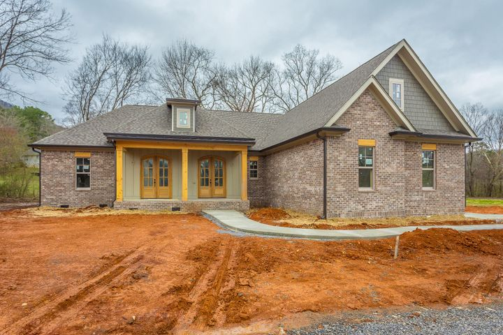 Welcome to The Meadows at Falling Water! A small, private community of homes with acreage lots and scenic views of Signal Mountain! Convenient location in the Falling Water area just off Roberts Mill Road before the ascent up Signal Mountain. Limited to only 4 acreage homesites in this charming community and only 2 homes remain for sale! The architectural style of this home is a blend of Acadian and French Country with three sides brick. A very comfortable ONE-LEVEL living plan featuring 3 Bedrooms, Office (with closet) and 2.5 Baths on the main level. Above the side-entry garage is a finished Bonus and Full Bath. The double wooden front doors are repeated on the Office/Study (or 4th Bedroom). The Master Suite is private and tucked away from the living area. Featuring separate closets, separate vanities, tiled shower, soaking tub and water closet, this Master Suite will impress! Above the side-entry two car garage is a finished Bonus and full Bath. Additional features include: Nine foot ceilings on main, mudroom, oversized laundry, walk-in pantry, open concept living plan, large kitchen island, gaslog fireplace and covered back porch. Call today for more details or visit us. Open House most Sundays 2-4pm!