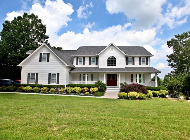 """Stunning home with motivated sellers!  BRING ALL OFFERS! This custom built home is a must see. The view is absolutely breathtaking! As soon as you walk into this beautiful home you will immediately notice the spacious rooms were designed for entertaining and having large family functions. Exhilarating natural light fills this special home. The formal dining room is perfect for family gatherings and entertaining. The open kitchen offers a tremendous amount of counter space, an abundance cabinet space, a large island and a huge pantry large enough for a refrigerator to be in it. The great room offers vaulted tongue and groove ceiling and floor to ceiling windows overlooking the stunning view of many mountains and the Tennessee River. See 3 states! The covered screened rear porch is a perfect place to relax or entertain while enjoying the ''million dollar view""""! This home offers four bedrooms. The master suite has the same """"million dollar view"""" and features separate shower and jetted tub with a walk in closet. An additional bedroom has a large closet and its own private bath. The other two bedrooms share a Jack and Jill bath for convenience. This home has an entertainment area in the basement perfect for a home theater and a recreation room. Set your appointment to see this special home today."""