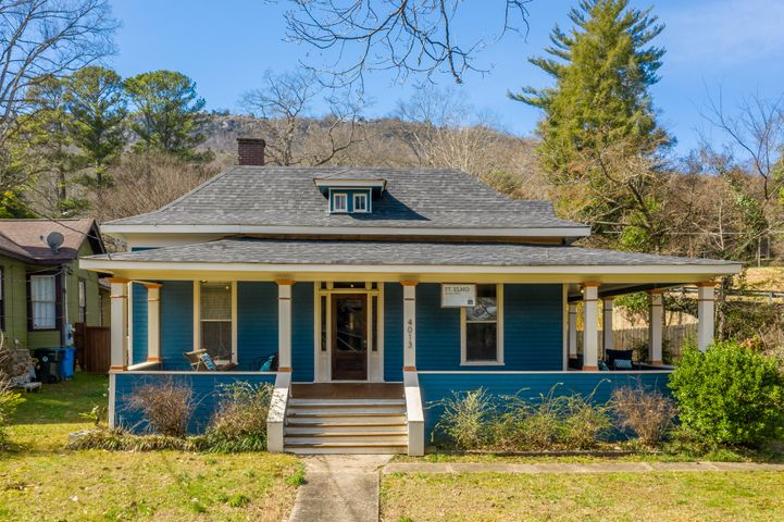 If you're looking for a high character craftsman home within one of Chattanooga's most sought after urban neighborhoods, look no further. One of the easiest walks (5 minutes) to St. Elmo Square where you can enjoy Plus Coffee, Mojo Burrito, TapHouse, 1885, Mr. T's, etc. This 1900's craftsman features a wrap around front porch, open concept kitchen/dining/living. Original hardwoods throughout most of the home. Updated kitchen with stainless steel appliances and granite counter tops. Beautiful built in shelving in the living room.  Brand new master bathroom addition featuring a stand up shower with body sprays, a claw foot soaking tub, double bowl vanity, and large master closet. Parking in rear beside drive for Roy Helms Park. Totally fenced in back yard. Back screened-in porch is perfect for storage. Come see this home while you can. Owner/Agent.