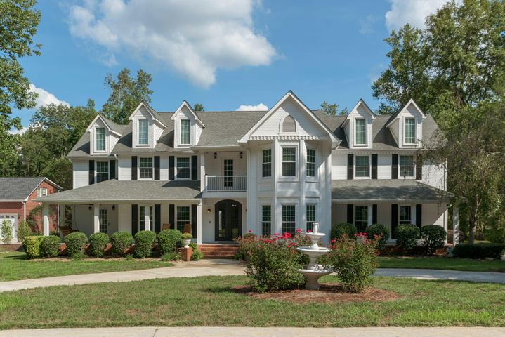 Southern living at its finest in prestigious Anatole! This timeless classic is truly an entertainers dream. The outdoor resort-like space is unsurpassed with architecture reminiscent of the Caribbean West Indies. This personal paradise includes a large covered cabana with full bar, entertaining space, and full bathroom with indoor and outdoor showers. Across from the cabana is a covered porch attached to the house, which includes a built-in hot tub, seating area with TV, fireplace, and grilling station. Perfectly nestled between the cabana and the deck is the custom designed pool with adjoining pergola. This home features 5 bedrooms, 5 1/2 baths, gourmet kitchen, great room, living room, dining room, 3 car garage and over 5,500 square feet of living space. Buyer will consider trade * MAJOR PRICE IMPROVEMENT** $60,000.00 REDUCTION Now being offered at $679,000.00