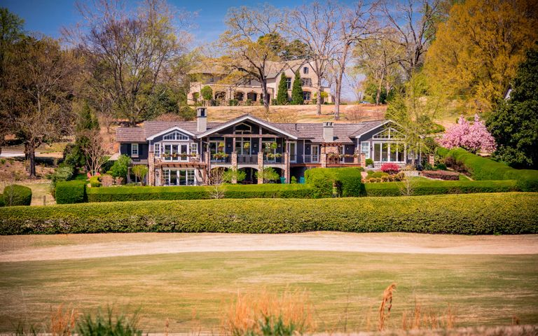 Rare Opportunity to live in this Prime Riverview location! Perfectly situated on it's lot to maximize views of the Chattanooga Golf and Country club, yet providing unparalleled privacy.   This 4 bedroom, 5.5 bath home has been meticulously re-built and updated (a 3-year process) with a floor plan for family living and ease of entertaining in mind. The new floor plan includes two additions on either side of the home, raising ceiling heights and opening up the living spaces.  No detail was overlooked providing a unique blend of  texture, craftsmanship and finishes  throughout  you must see to appreciate. Some of the upgrades include 100-year-old reclaimed barn wood floors, beamed ceilings, mushroom wood wainscoting,  custom built-in cabinets, and the finest fixtures throughout. Your guests will feel welcomed as they pull in the  front porte-cochere with custom lantern chandelier. Step inside to the spacious foyer with the formal dining room to the left. The great room with marble and stone fireplace is open to the kitchen and dining area which is perfect for family living and entertaining. The Chef's dream kitchen features granite counter tops, tile back splash, top of the line stainless appliances, under cabinet lighting and desk area. Step through the French doors to the office/library with custom built-in shelving that includes 6 pull-out desks and a gas fireplace with access to the rear deck. Across the hall is the movie room with theater seating and automatic curtains. The master suite is on the main level with gas fireplace, vaulted ceilings and you have a private porch overlooking the golf course.  The spa-like master bath is a true retreat with separate vanities, steam shower with body jets, and garden tub. The custom walk-in closet has built-in cabinets with cedar lining and pull out drawers. There are 3 laundry rooms that are situated conveniently throughout the home. On the opposite end  of the main level there is a large bedroom with en-suite complete with reclaimed Carolina red barn wood on the walls and a loft area that is the perfect spot for reading or studying, plus  access to a private porch. The terrace level has a living room that is open to the entertainment area with a gas fireplace, 2 additional bedrooms each with en-suites, and access to private patios and an additional full bath. This home has fantastic outdoor living space with a covered terrace, hot tub, and a gas or wood-burning fire pit all surrounded by a beautifully landscaped yard that the kids and pets will also enjoy. Chattanooga Golf and Country Club, with it's recent upgrades and investments,provide the ultimate lifestyle in the most convenient of locations.