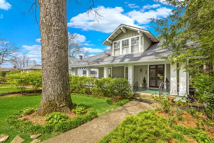 Combining comfortable elegance and mountain charm, 209 Richardson Street is located on a quiet, sidewalk-lined street in an older section of Lookout Mountain. Built in approximately 1915, this welcoming, family-friendly home features 5 bedrooms including a main level master, 2 full baths (master bath renovated in 2014 to include heated floors), 2 half baths, 9' ceilings, gorgeous hardwood floors, an inviting front veranda, back deck, and lovely shaded brick patio in back. The kitchen, a cook's delight with gorgeous maple and tile countertops, Thermador oven and dishwasher, and Sub Zero refrigerator (all less than four years old), leads to a cozy den with a wall of book shelves. Upstairs, there are 3 bedrooms, a full bath and a spacious living room area. Downstairs there is a laundry room, office/study, arts & crafts storage room, and a large, light-filled artist's studio or workout room. The owner has gone to great lengths to maintain the home's original charm, restoring the kitchen cabinets, doors and other historic features. You will love strolling around the point or heading to nearby Clumpy's for ice cream on a warm summer night. Don't miss this rare opportunity to own a unique and charming older home on Lookout Mountain, a small, family-friendly community known for its stately homes, quaint and winding streets, award-winning elementary school and Mayberry-RFD-like atmosphere. OPEN SUNDAY, April 7th, 2:00-4:00