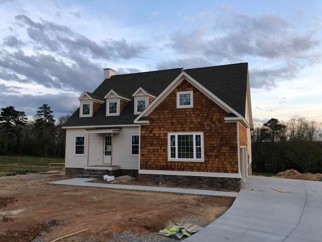 This is the last new construction in the neighborhood and is on the largest premier lot. This large cul-de-sac lot that backs up to a long time horse farm and has views from every room on the back. The home was designed after the 2015 HGTV Dream Home in Martha's Vineyard. The first floor is an open floor plan with tons of room for entertaining and also features a large Master Suite. There is a large covered/open deck on the back of the home facing the woods with an outdoor fireplace. There are 2 Bonus/Play Rooms on the second floor and there is still a decked walk out storage area. Contact us for more information on this home.