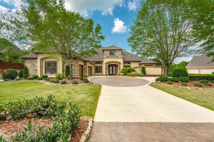 This home sits on a truly Premier lot in Prestigious Council Fire Subdivision on the TN side. Overlooking Hole #2 of the golf course, this beautiful house offers everything you could every want! Featuring tons of natural light w/ good-sized windows allowing nature through w/o the bugs. The Master and 2 additional bedrooms are on the Main floor. You'll find gorgeous travertine throughout. The Study boasts a wall of handsome custom built cabinetry. Don't forget to save extra time to view the outstanding Wine Cellar... a wine collector's dream! The outdoor space is just as amazing w/ plenty of room for entertaining. There's an in-ground pool, gazebo, firepit, grill area and bar. Still want more... how about an elevator! Yes, your personal elevator. Come see for yourself ~ Call today!