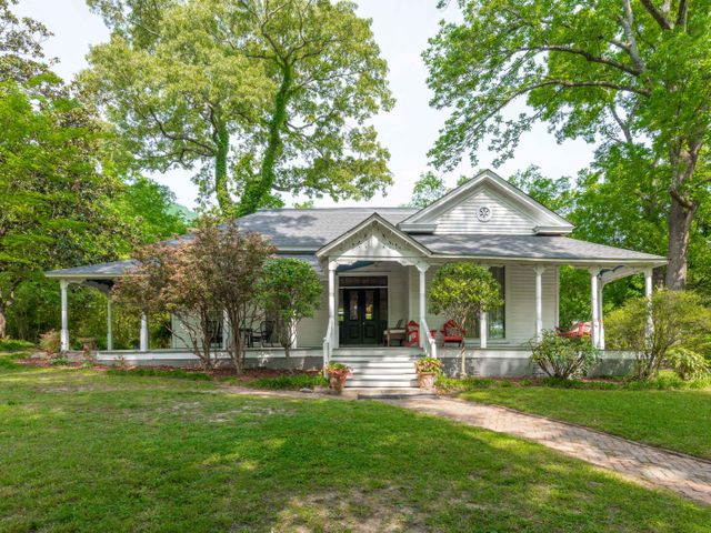 Price Improvement!  Welcome Home to one of St. Elmo's oldest historic Victorian homes.  The ''Sissons House'', resides on 1.38 +/- acres at 113 Ochs Highway.  Built in 1884, one year before St. Elmo was incorporated, and within a decade that Bessie Smith was born and the Walnut Street Bridge was built, makes this gem of a home a one of a kind opportunity presenting itself formally to the market.  The Sissons House is sitting on one of the most desirable locations in all of St. Elmo.  Located within a few minutes walk of St. Elmo's thriving business center, still it offers a quiet privacy provided by the mature flora and fauna on its grounds, including oaks, magnolia trees, Japanese maples, redbuds, dogwoods and fruit trees. It's difficult to overstate how incredible of an opportunity it is to be the next proprietor of this charming home.    The Sissons House takes us back in time 135 years to a period of craftsmanship that is unparalleled in today's modern construction. A sampling of the original features include 11' high ceilings, historic trim and moulding, four working gas fireplaces, a wrap around wooden porch, french window doors, wood floors, interior transom windows, and hand painted porcelain sconces.  The Sissons House is breathtaking and unique in every way.    Built as a summer residence, the home's original layout featured a dogtrot which functioned as an open air breezeway for the historic proprietors' pets and family to pass through the heart of the home to the outdoor kitchen.  Today, this dogtrot presents as an enclosed and enlarged hallway that highlights the detailed trim work of the original soaring arches. The Sissons House showcases a wooden wrap around covered porch with restored and original wooden Victorian corbels lining its entirety.    A formal parlor is secured by large internal double doors. The french door windows provide sun-kissed natural light and an original mantel framing a see-through gas fireplace that peaks into the kitchen. All