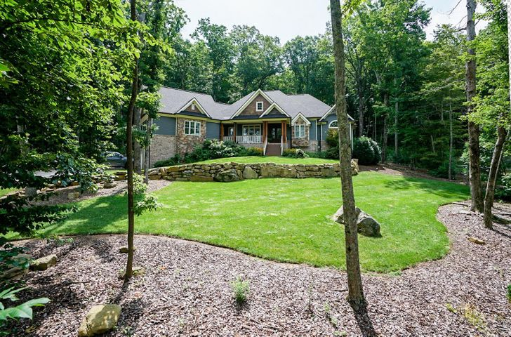 Wow, custom meets luxury. This spacious two level, 6 bedrooms, 3.5 bath home sits on a private 1.9 acre lot surrounded by boulders and beautiful landscaped lot. Nearly all the living space is on main level which boost a beautiful large kitchen with generous amount of custom cabinetry, large pantry and top of the line appliances. Thermador range and dishwasher, extra large Frigidaire refrigerator. Hearthroom with stone fire place off the kitchen along with another large living room makes for perfect entertaining. Living room has spectacular windows overlooking the mountain boulders in backyard and onto large patio that offers another space to entertain. The home also has large laundry room with custom cabinetry, generous playroom with large closets, and two offices which could be used as b .rooms. Master bedroom has a tray ceiling and a well appointed master bathroom with soaking tub, walk-in steam shower, his and her vanities and large walk -in closet with custom shelving. Three bedrooms offer a jack and jill bathroom. On second level you will find guest bedroom with full bath. Last but not lease off the three car garage is a ginormous basement space that is perfect for