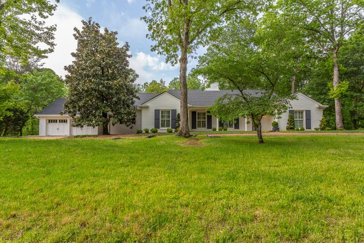 Remarkable, basically 1 Level like-new home on beautiful level lot in most sought-after Tenn neighborhood of Lookout Mtn.It was designed & rearranged by an architect & in 2018 completely reworked again .On the main level are the corner,sunlit master suite having a new DELUXE master bath w/ garden tub, dbl vanities, walk-in sep shower & walkin closet ,stg galore.A new guest bath is adjacent to the mbr (gives MBR 1.5 baths!) & office niche.There's a second br/office+another new bath & laundry on the main level.Very open new arrangement of the family room (f/p), living r kitchen flowing graciously into the 24'sunroom (where your breakfast table can overlook the boulders).The sunroom has 3 walls of windows & also overlooks the new stone patio built around a 100 yr old oak tree /fenced yard & massive boulders. 2 very private oversized bedrooms are upstairs having a fabulous, handsome new Jack'Jill bath and a gallery-styled play/sitting area w/ bookcases galore. The slate floored mudroom that's between the oversized 2 or 3 car garage and the kitchen have convenience & kiddie/adult/hanging storeage that's unbelieveable.3 pantries. There are 3 attics ( 1 finished) that could be used as a workshop or hobby room. NEW FEATURES : Hardiboard exterior concrete siding where there is not brick;permanent painted pvc trimwork(can not rot): new circular stone patio around an old oak tree & new rear custom fencing ;prime/best LINCOLN dbl pane windows:all new granite,marble, guartz countertops & all new fashinoable CUSTOM cabinets including many builtins such as 2 desks, a hutch ,pantries(3+) , closets & bookcases; new insulated garage doors; waterheater; AMANA HVAC units('18,'07) ; all of the solid wood doors & hardware , molding, casements; the hardwood floors throughout refinished & relaid where needed; Plantation shutters & electricly controlled blinds; complete interior/exterior painting.The wiring has been completely checked, gone over & added to by LAWSON ELECTRIC .The 9' ceiling