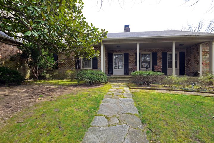 First time on the market! Rare opportunity to own this custom, one-level, all brick home situated on 2.67 +/- acres in the heart of Lookout Mountain, TN. This one-owner home has been well loved and enjoyed and is just awaiting a new owner to come make the desired updates to make it their own. The seller recently replaced the stamped concrete patio, and you will love that it has skylights and ceiling fans such that it can be utilized throughout most of the year, plus it overlooks the lush back yard, raised garden area and surrounding woods which provide wonderful privacy. Mostly hidden from view of the street, the home has a covered front stone porch and formal entry. A handsome library is just off the foyer and has a gas fireplace and built-in reading nook with bookshelves. The living room is spacious and also has a fireplace, as well as access to the rear patio, formal dining room and breakfast room. The kitchen is situated between the dining room and the breakfast room which also has access to the laundry/mud room with side entry from the driveway. A back bedroom is versatile with an updated private bath and a small kitchenette that would make a great in-law suite or even a bonus room. Access to the basement garage and cellar storage is just off of this space, as well. The master suite was a later addition and is on the other end of the house. It is more than large enough for a sitting area and is separated from the master bath/dressing area via a large armoire. To enter the master bedroom, you pass through a sitting room that was once a bedroom and would also make a great nursery and has closet storage. The original master is on the back of the house and has a private bath and 2 closets. A 4th bedroom and full hall guest bath round out the floor plan. If storage is a must, you will love the huge attic for seasonal items, the cellar for lawn and garden supplies and the outbuilding once used as a small art studio. Truly a fantastic find for just the right buyer, so