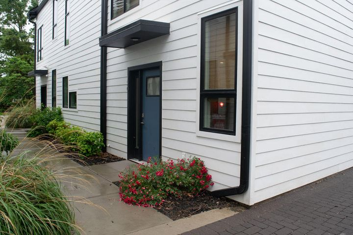 Walking distance to Southside - This three level unit features a living space and kitchen on the lower level - Kitchen has Quartz counter tops and pantry - finished concrete floors - Second level Master Bedroom and Full Bath - Third level can be whatever you want it to be second bedroom,office or entertainment space - Private terrace on third level = Parking on site