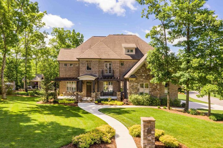 Owning a home becomes a lifestyle in this full brick & stone custom home drawn & built in Signal Mountain's very desirable Bluff Creek at Fox Run. From the moment you enter, the tone is set for exceptional living. Site finished hardwoods, generous baseboards & moldings reinforce the quality & great style throughout. Open floor plan that invites casual living with the family room, oversized kitchen, eating area and porch (bringing the outdoors in) to function as one spacious room. Privately tucked away master suite is truly a retreat on the main level with hardwood floor and spa quality bath. The kitchen is as functional as it is gorgeous with a rich mix of painted & glazed cabinets impeccably blended with warm wood finishes. Expansive center island is the absolute best design for food prep and service, allowing all the cooks in the kitchen (at the same time) or for serving a group. Commercial grade stainless appliances include six burner gas cooking with double ovens & 48 inch built-in refrigerator. Kitchen is completely open to spacious keeping room with fireplace flanked by built-ins for maximum storage surrounded by windows overlooking backyard paradise. Second level offers three bedroom suites. Custom designed study niche in loft area makes study easy and easily accessible to mom or dad. Bright bonus room with hardwoods. Covered porch with wood burning fireplace overlooks the pool with gorgeous stone pavers surrounding it creating a luxurious sunning area, shade a pavilion and large fenced play area. Let home become your daily escape to Signal Mountain while being just minutes of Downtown Chattanooga to work, top tier dining, shopping & entertainment. *Pool furniture does not remain.  TVs do not remain.