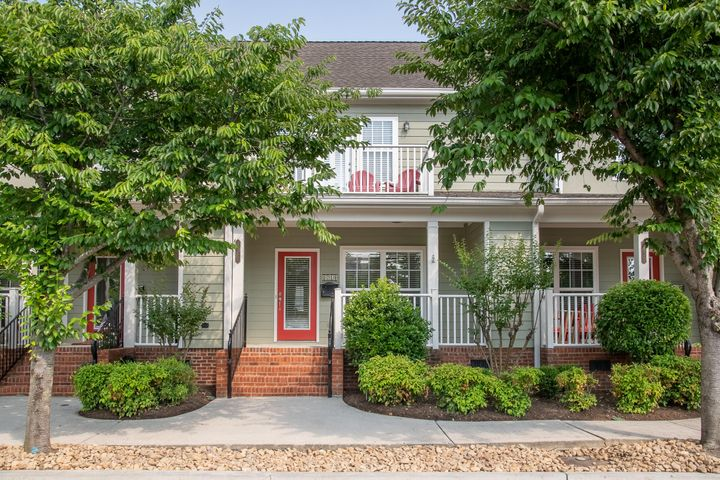 Location, Location, Location! In the heart of the Southside this townhome is walking distance to all of Chattanooga's best restaurants and shopping on Main Street! 3 bedrooms with a private balcony off the master suite perfect to enjoy your morning coffee.  This townhouse also features huge walk in closets, 2 1/2 baths with tile floors, hardwood flooring throughout, granite counters, stainless appliances, and many other upgraded amenities.  The large outdoor back patio is a dream for entertaining and also features a doggie turf area. The 4 dedicated parking spots (2 under the covered carport area) are a rare find in downtown living.  There are 2 storage areas for tons of storage.  Purchase with confidence as this home comes with a 1 year home warranty!  Schedule a showing today!