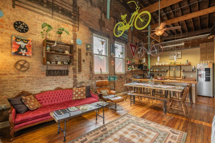 One of a kind condo, where an eclectic escape meets the convenience of walking to Chattanooga's exciting city life. Currently a very successful AirBnb, you can be assured no detail has been overlooked! 1617 Rossville has been completely renovated and restored by a local nonprofit founder; everything from the salvaged heart pine wood floors to the creative wall decor. Relish in plenty of natural light from the oversized windows and bright colors throughout. The tall ceilings and exposed beams leave a story to tell; while the cabinetry and countertops are antique heart pine, taken from the trusses of the building. Enjoy the open living and kitchen space with stainless steel appliances. The master gives way to a spacious bedroom and bath with double vanities and generous walk-in shower. With just a few steps, take your gazes to the rooftop deck where you can experience some of the best views of Lookout Mountain and popular Southside. Listing price reflects the sale of the space fully furnished. You don't want to miss out on this incredible investment!  **HOA Fees cover wifi, insurance, Building needs, standard HOA needs, etc.**
