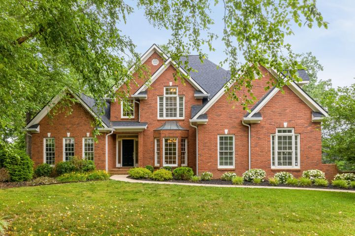 This exceptional all brick home was custom built with full attention to design and detail.  The location could not be better with easy access to I75, shopping, and dining.  The home is situated in a quiet cul-de-sac on a private and level wooded lot that is extra large.  ***This home has a hard to find floor plan with the master on the main as well as an additional bedroom on the main floor with an en suite bath.  ***When you enter this well maintained home you will immediately feel the pride in Ownership it offers.  There are soaring ceilings and large windows that allow for plenty of natural light throughout that shines over the hardwood floors.  *** The foyer is vaulted and spacious and opens up to a lovley dining room with updated lighting and wainscotting. It is also adjacent to a formal living room or study that is a bonus to this wonderful floor plan.  The Greatroom has a beautiful fireplace and columns with with heavy moldings flanking the openings to the loft above.  The master suite is very spacious and has a triple trey ceiling and lovely large windows.  The master bath is spa-like and offers separate vanities, vaulted ceilings, custom cabinetry,  and a very large walk in closet.  ***The kitchen is an entertainers delight with granite, tiled backsplash, custom alder wood cabinets, stainless appliances and a spacious pantry.  The main level also includes a half bath and an oversized laundry room with custom cabinetry, a sink, and shelving.  ***The second level of the hame has a large loft space, two additional bedrooms and a large bonus room that is also perfect for a fifth bedroom.  The bonus room has wonderful built in shelving and there are very spacious closets throughout.  There is also a niced sized walk out attic space offering plenty of storage.  There is also a brand new roof, a new lower level HVAC unit, and new decking. ***This home has the perfect combination of a fabulous location and very quality construction.  Schedule a tour today and be re