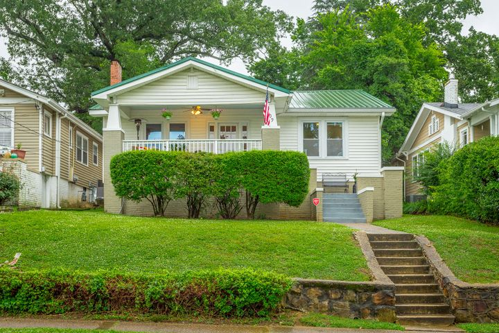 LOCATION!!!!!! Updated Young Ave bungalow with tons of charm! Completely new bath, updated kitchen, original hardwood floors, stone decorative fireplace. Covered front and back porches, off street parking, spacious rooms and high ceilings!! Walk to all from this adorable home!