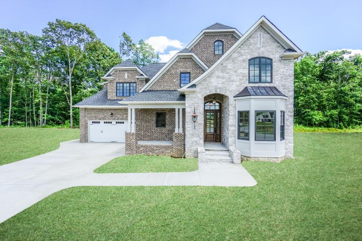 This home is a custom Estate home with 75' lot frontage built by Ironwood Builders and has 5 Bedrooms and 3.5 Baths.Walk in from the rocking chair front porch to a beautiful modern foyer with entrance to an Office/Flex Room and  Formal Dining Room, then opens up to a large open concept Kitchen, Great Room complete with fireplace, and Breakfast Room. The kitchen includes a large island and spacious butler pantry with access to the Formal Dining Room. Additionally, there is easy access to a half bath and a separate laundry/utility room. The private Master Bedroom Suite is located away from the rest of the downstairs living space with a large Master Bathroom including separate vanities, and Walk-in Closet. The Master and the Great Room both have access to a private covered porch on the back side of the home. Upstairs are four large full bedrooms with walk-in closets. Each pair of Bedrooms have access to a jack and jill bathroom with separate vanities. Plenty of walk out attic space can be accessed from the upstairs. This home includes a two car garage accessed from the front of the home with a separate garage door on the side for golf cart parking or additional storage. The majority of our homes feature large, functional front porches, garages in the rear of the residence, immaculate landscaping and parks, and an intricate sidewalk system that connect you to your neighbors and the growing Cambridge Square Commercial District. Models are open from 1-5 each day!