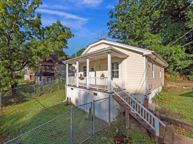 Move into Lupton City with this totally remodeled minimalist charmer! Open-concept living room that leads into the brand new kitchen including granite counter tops, cabinets and new appliances. Large kitchen island doubles as a dinning area for saved space. Open shelving provides good storage options without limiting the feel of the space. Master bedroom has en-site bath with large tile shower. Second bedroom and bathroom with tub/shower combo. There is a separate laundry room with washer and dryer connections. New HVAC, partially updated electric and plumbing. Enjoy the charming front porch and already fenced in yard for your dog! Definitely a home you need to see. Schedule your own private showing today!