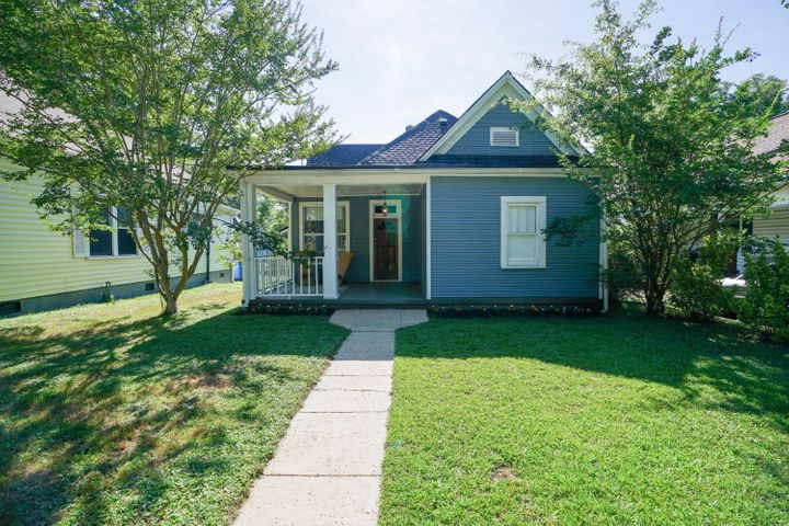 The cutest bungalow in Historic St. Elmo a block away from the St. Elmo Park. Newer HVAC and NEW ROOF!  This home has all the charm of the early 1900's. Hardwood floors throughout the home. Soaring ceilings in the den/family room with tons of light from the large windows. Master bedroom has tall ceilings with large closet space and hardwood floors. Guest bedrooms are both a good size, have tall ceilings and hardwood.  Bathroom has been remodeled with subway tile and updated finishes. Kitchen has great cabinet space and gives access to the rear of the home with a covered patio area.  Basement/cellar has wonderful storage.  Rear of home has plenty of off-street parking from the back alley. Home is only minutes to Southside and Downtown Chattanooga. Call today to schedule a showing!