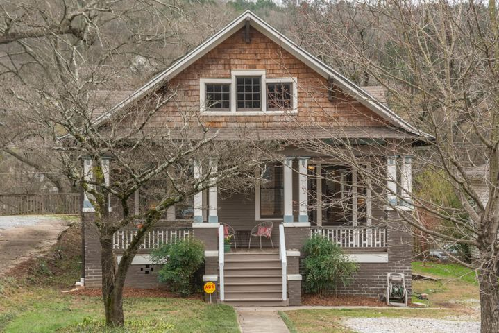 CUTE St Elmo home on St Elmo Avenue.  Home has warmth and charm and has wonderful curbside appeal. It won't last long!  A great starter home in one of the most desired neighborhoods in Chattanooga. Front AND large fenced back yard!  Wonderful shaded sitting porch in the front.  A craftsman style home with 3 bedrooms, fireplace, hardwood floors, cozy eating nook next to kitchen and more.  Come fall in love with this charmer before it's gone!