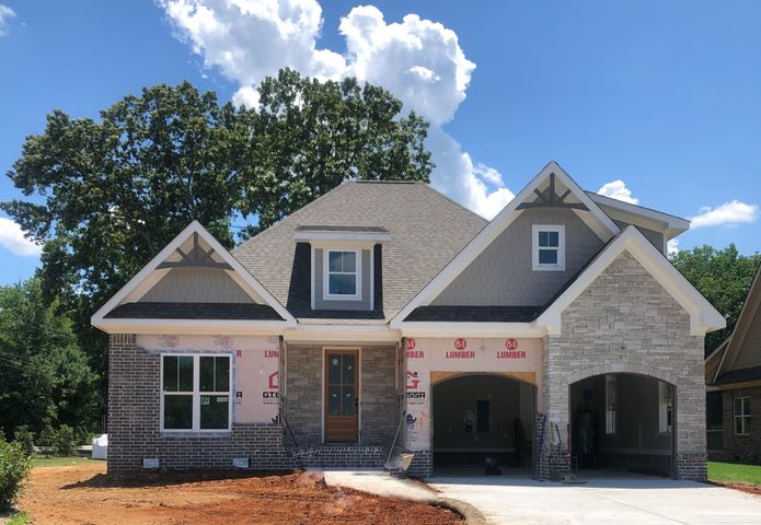 Welcome Home to 2323 Large Oak Drive in the beautiful Oakhaven Fields subdivision. Located in convenient Ooltewah and zoned for popular Apison Elementary and East Hamilton Middle/High Schools. You're sure to fall in love with this open floorplan which features the high end quality GT Issa Premier Homes is known for. This home offers site finished hardwood floors, upgraded kitchen, an open floorplan perfect for entertaining, & large covered porch to enjoy on those summer nights. The master en suite is on the main level along with a guest room. Upstairs is another bedroom and huge bonus room where the family can spread out. *Photo is of GT ISSA floor plan elevation that will be very similar to this home. *4+ months to completion.