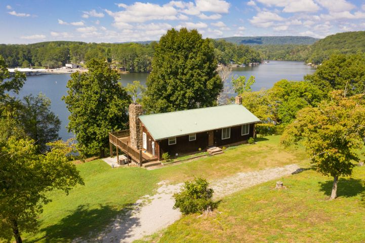 Rustic Home on stunning lake front property. Beautiful views throughout the house. Potential for a mother in law suite or apartment with its own access point. Deck and covered patio overlooking the water. Large boat dock with deep water boat slip.