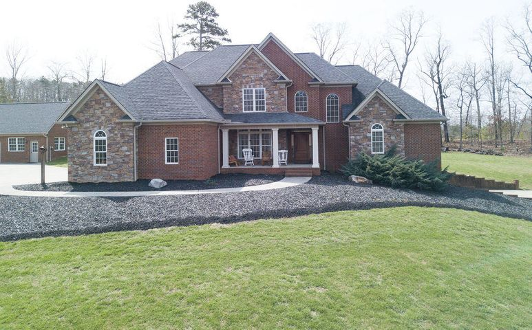 Amazing custom built one-owner home on over 5 acres! This lovely home has lots of living space! Main level offers formal dining room, great room with gas fireplace and vaulted ceiling, keeping room with wood burning fireplace, kitchen with high-end granite, knotty cherry cabinets, breakfast nook, walk in pantry...master suite has trey ceiling and door to patio plus master bath offers double vanity, jetted tub, tile shower with two shower heads. Double attached garage on main level. Upper level boasts three bedrooms with two full baths plus finished bonus room. Finished basement offers true separate living qrts with has kitchen, den, walkout door to exterior, full bath, 2 additional rooms (could be used as bedrooms), plus additional laundry room, large storage room and single car garage with driveway! There is a laundry room on every level. **Separate building is also full brick with 936 finished sq feet is plumbed for kitchen and bathroom and could be separate living quarters...it is currently being used as an office and workshop. This building offers an additional 504 unfinished sq ft in garage. Main home has 3 HVAC units (one on each floor) plus HVAC unit in detached building. 5.02 acre lot is beautifully landscaped with fruit trees, garden spot, Shed and fire pit! Home warranty offered! EPB fiber optics available!!!