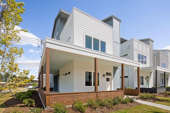 With a Clean and Contemporary design, Collier has created a community with homes that are not only aesthetically pleasing but thoughtfully designed to be efficiently livable. With 2300 square feet, this home lives large and can be a springboard to your life in Chattanooga. Here, you can enjoy the sunsets and views of Lookout Mountain. For life that happens away from home, jump on the Riverwalk for pedestrian access to downtown entertainments or the Historic St. Elmo Community.  This home is the last home to be built at 100 @ South Broad.  Price reflects corner lot and additional wraparound porch.  Schedule your showing today!