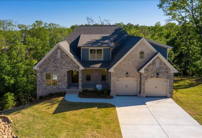 Welcome to the home you've been looking for.  Some of the highlights of this home are all-masonry exterior finishes, on-site finished hardwood floors, specialty ceilings, wainscoting, stack stone fireplace, beautiful glistening white kitchen, custom range hood, farm sink, abundance of custom cabinets, Kitchen Aid appliances.  This is a dream kitchen! Large master bedroom with specialty ceiling and the master bath is complete with a soaking tub.  --  The Great Room's signature is a large gas-log fireplace and a bar/eating areaa great place to share meals or just hang out. Custom kitchen cabinetry, gorgeous trim, designer paint selections, specialty ceilings, and walk-in pantry are certain to wow you!   The home has two amazing decks that have spectacular views. The home is located on a very quiet cozy Cul-de-sac.  Window Screens no longer come on new construction homes.