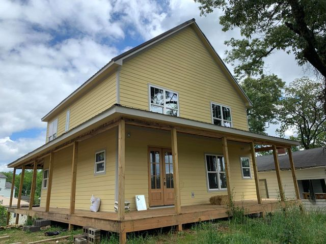 Partially completed new construction sold as is, where is in the heart of St. Elmo.   Views of the Incline and Lookout Mountain from the wrap around porches.   Tremendous investment potential in a prime location.   Owner/Agent