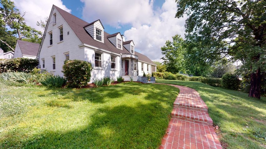 One of the most beautiful streets in all of Chattanooga, Belvoir Avenue is a charming street full of timeless architecture and wonderful families who call it home. This is your chance to enjoy the lifestyle Belvoir affords. This classic painted brick home has curb appeal for days. Upon entering the welcoming foyer, you will immediately notice the beautiful hardwood floors. An oversized living room with fireplace leads you to one of the seller's favorite feature, a stunning sunroom.On the other side of the foyer, you will find the beautiful dining room, perfect for entertaining. The updated kitchen has storage galore with a fantastic butler's pantry. In the back of the main level you will find the master bedroom, complete with double closets and bath. As you climb the grand staircase to the upper level, you will notice the cozy reading nook at the top of the landing. There are also two large bedrooms with excellent storage and a second full bath. The home also has a full unfinished basement with laundry and copious amounts of storage. Another special feature of this home is the private fenced back yard, perfect for pets, children, and your own personal getaway right in the middle of the action. The home is on a corner lot and has a large detached two car garage. Updates include all new HVAC upstairs and down, installed in April 2020. There is all new electrical throughout the home, as well as new insulation, rebricked chimney and fresh paint throughout. Also, a new roof is coming soon! The sellers love the neighborhood farmers market and easy access to the BX. And, did we mention you are 10 minutes from downtown Chattanooga and 10 minutes from Hamilton Place? This gorgeous home is ready for your family. Copy and paste this link to take a virtual tour https://my.matterport.com/show/?m=xSG75ihPVHa&brand=0  or schedule your private showing now, before this one gets away!