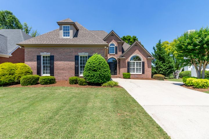 Consider living in one of Chattanooga's premier golf course communities in this beautiful all-brick home with great space, a master suite on the main level, and upscale amenities. The main level includes, the foyer, formal dining room great room (with a gas-log fireplace and built-in cabinets), wet bar, powder room, kitchen (with an island, a walk-in pantry, stainless appliances, and plenty of cabinets), laundry room, garage, the master suite (with two master closets, and a spacious bath with a jetted tub and separate shower).  A new deck with solar lights is accessible through the breakfast room.  Upstairs is a loft with skylights, a telephone booth, two bedrooms separated by a full bath, and a huge bonus room with attic storage.  Make an appointment to visit today.