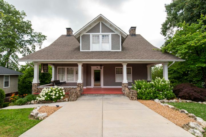 This 1920's Missionary Ridge bungalow has been completely renovated.  In keeping the original charm it also marries style and modern convenience.  Enjoy spectacular sunrises and stunning sunset views that fill this home with natural light.  The chef's kitchen and luxury Master Bath make this house a home.The historic home offers 3285 square feet, the perfect home with plenty of room for guests.  Features to note are the original heart-of-pine flooring, 8'' cap moldings, granite countertops throughout the home and a gorgeous granite backsplash in the kitchen.  Enjoy high-end Kitchen-Aid stainless steel appliances, gas range, wet bar, two sinks, large island, and plenty of room for seating.  The custom oversized cabinetry shines a unique finish and scrolled handles. The Master Bath is a show stopper! You must see the walk-in limestone shower, double vanities and incredible soaking tub.  the other 3 Bedrooms and 2 1/2 Baths have been updated for style and convenience, including modern neutral paint colors.  The renovation includes updated electric, new plumbing, and the original chimneys have been fully lined and capped.  You will love the recently installed fence and well landscaped lawn.  Watch the sunset over the ridge from the front porch, or take in the serene view of White Oak Mountain on the expansive deck.  Only 5 minutes from Downtown Chattanooga, this home gives easy access to all the best the city has to offer.  BUYER TO VERIFY SQUARE FOOTAGE.