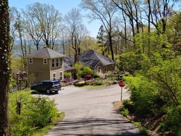 Beautiful mountain home in tranquil setting, but minutes from all that Chattanooga has to offer. This move in ready, updated home has it all: hardwood floors, granite, tile, updated light fixtures, recessed lighting, crown molding & stone wood burning fireplace, huge master,deck. Views!! Hike/bike from the front door! Super active & friendly neighborhood.