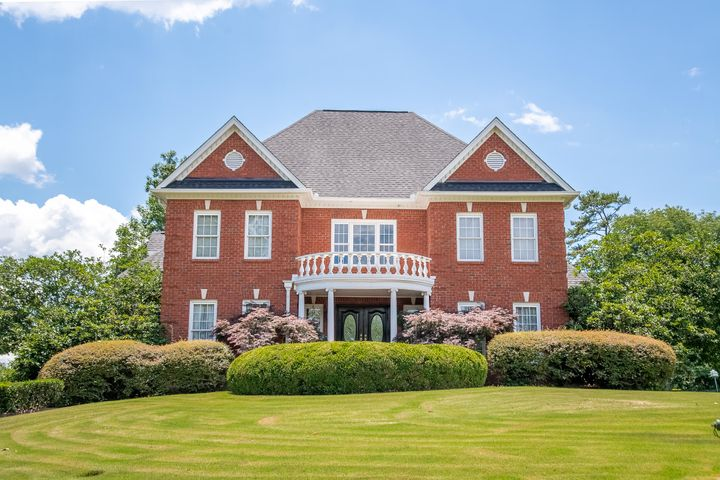 Feast your eyes on this stunning all brick home, situated on an oversized corner lot. You'll be captivated by the grand beauty of the two story foyer, that flows seamlessly into both living and dining room. A fantastic, large kitchen with elegant, custom cabinetry, gorgeous granite counter tops and oversized granite-topped work island opens to the family room with a two sided, see through, wood burning or gas log fireplace. Convenient, large laundry room is adjacent to the kitchen. Enjoy kitchen/den access to a sunroom and a huge open deck overlooking a beautifully landscaped yard. All this allows for a serene setting for entertaining or relaxing. Upstairs you find an oversized master suite w/ an additional sitting room that would be perfect for an office, nursery or work out area, and an additional sunroom for year round enjoyment!  There are two more enormous spare bedrooms, each with their own bath and walk in closets. Just down from the main level is the walkout, daylight basement, perfect for a mother-in-law apartment or a teen/college suite, complete with a full kitchen, exercise room, guest bedroom and bathroom, and large family room with a wood burning or gas log fireplace, and plenty of storage. French doors open out onto the lower level patio into the back yard with lush landscaping. Fabulous landscaping lends to the charm, beauty, and superior quality this wonderful home offers.  Conveniently located in Eagle Bluff within 15 minutes to all that is Chattanooga including Downtown, Hamilton Place Mall, Volkswagen, Amazon, Cambridge Square and Chattanooga Airport.