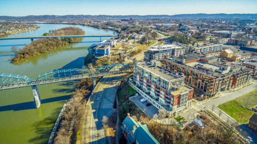 Welcome to the prestigious and highly sought after condominiums of Museum Bluffs! This condominium is just a few minutes walk away from two of the most popular landmarks in Chattanooga, the Walnut Street Scenic Pedestrian Bridge and the Tennessee Aquariums! Nestled conveniently in between downtown Chattanooga and the beautiful Northshore area with the best shops and restaurants all within walking distance. Enjoy the magnificent views of the Tennessee River and the North Shore on your expansive balcony while having your morning coffee or while entertaining guests. The epitome of elegance and comfort, the open living space is lined with craftsman site finished hardwood and 14 foot ceilings. With no home maintenance required, your valuable time can be put towards the more important things in life, like spending time with family or laying back and enjoying your favorite book. Call and set up your private viewing today!!  Seller may consider leasing the unit. *Water is included in the HOA dues, which are based on unit square footage. Electric and Internet are not included and there is no Gas to consider. Two parking spaces are included, one in the garage, parking space #21 and one outside, parking space #46.