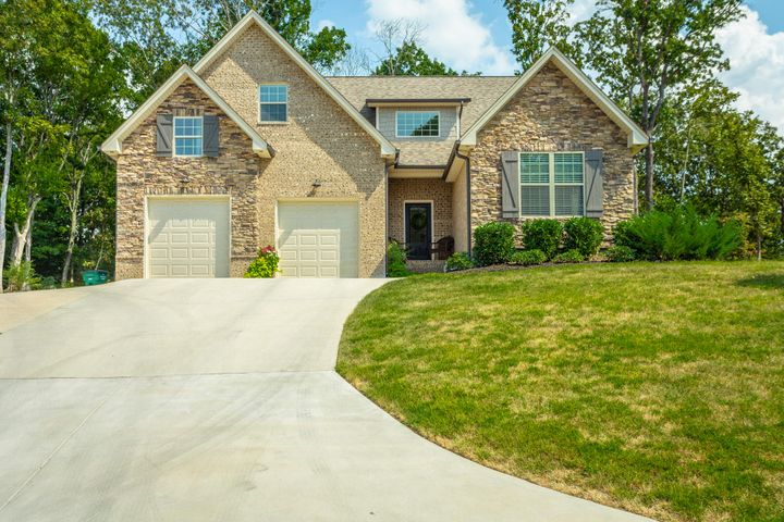 Welcome to Riverbay Estates! This incredible 4 bedroom, 3 bath home is less than two years old! GORGEOUS kitchen with beautiful cabinetry with a gas cooktop, island for work space and seating, and under cabinet lighting. Beautiful vaulted ceilings in the living room and master bedroom. The master is on the main level and features a wonderful bathroom with granite countertops, two sinks, a soaking tub, tile walk-in shower, and walk-in closet. Upstairs features three bedrooms and a large additional bonus room. Private back yard, 2-car garage, and NEWLY renovated driveway for extra parking, and accommodating guests. Riverbay Estates is a beautiful community that offers sidewalks, and a wonderful family environment for you to enjoy. Convenient to area schools, grocery choices, the Chattanooga Airport, Volkswagen and only 25 minutes from Downtown Chattanooga. A stone's throw from Chickamauga Lake - Boat ramp within one mile from neighborhood. If you are searching for a home in Chattanooga, then be sure to schedule your tour of 5082 Abigail Lane today!