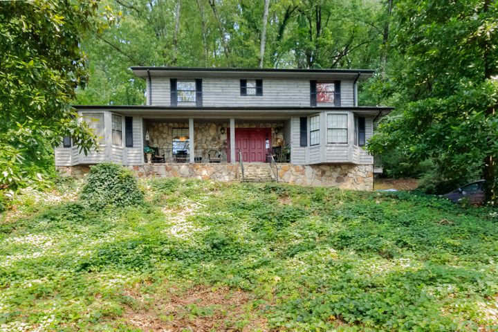 Beautiful home on the side of Missionary Ridge. Convenient to interstate 24 and downtown dining and entertainment. Winter views of the city are breathtaking. Main floor has beautiful hardwood in the entrance foyer, dining breakfast room, small mud room and kitchen. Carpet in living room, study and master bedroom. Master has 3 closets. Upstairs you have 2 full baths and 4 bedrooms. One of the bedrooms has built in shelves and would make a great home office. Downstairs in the finished area of the basement you have a complete kitchen, bedroom, living space and full bath with a separate entrance. Wood flooring in the basement has been recently installed. This would be a great mother-in-law or teen suite. In the unfinished area you have more space for storage than you can ever fill plus room to park two vehicles. New metal roof was installed in 2020. With acceptable offer seller will offer a driveway allowance and repair allowance of $15,000.
