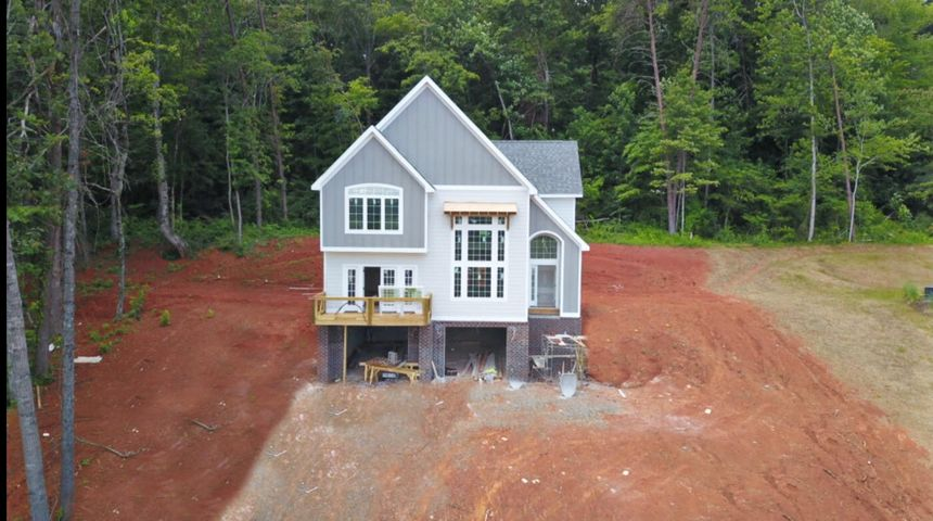 The home will be completed early Fall 2020! This gorgeous, new construction home in Red Bank that is anything but cookie cutter! Huge windows in the living room and master bedroom provide plenty of natural light and beautiful views of the surrounding hills. As you enter through the front door, you'll notice the towering ceiling, see-through fireplace, real hardwood floors and exposed upstairs loft that creates a very dramatic entrance. The granite counter tops, stainless steel appliances, and large eat-up island are just some of the beautiful features in the kitchen, which has it's own keeping room. The keeping room has a fireplace, built-ins, tons of natural light, and French doors that lead onto the balcony with fantastic views! The master suite features a vaulted ceiling, en suite with oversized tile shower, double-vanity and huge walk-in closet. Upstairs there are also two additional bedrooms and a shared full bathroom. The garage is oversized with lots of storage and plenty of room, plus oversized parking pad at the top of the hill to provide plenty of parking for guest. Tucked away on the quiet street of Glenhill Drive, yet conveniently located just minutes to Northshore and Downtown Chattanooga, this immaculate home won't last long! Get in now to be able to choose your finishes in the home (paint color, flooring, cabinets and more)!