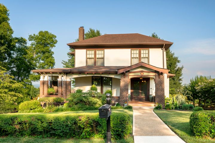 Fall in love with this fully restored Craftsman American Foursquare home.  Missionary Ridge residents appreciate the convenience and location; less than ten minutes to downtown and Hamilton Place Mall. This historic home, built in 1915, has three spacious bedrooms with walk-in closets and two and a half baths with incredible panoramic views.  Large rooms and modern amenities throughout wraps one in all the warmth and charm of yesteryear.    Entertaining is a breeze in a chef's kitchen including custom cabinets, three sinks, Thermador gas appliances, two refrigerators, two dishwashers, double ovens, microwave and warming drawer, leathered granite and soapstone countertops and floor to ceiling tiled walls round out the features in the kitchen.   Historically restored rooms with red oak trim, hardwood floors, hand printed period wall papers and historic lighting add a touch of charm and warmth not seen in today's construction.  Plenty of additional storage is found in the full unfinished basement which includes a workshop, office space and two-car garage.  Enjoy outdoor living year round on the wrap around porch and patio surrounded by a panoramic view of the Chattanooga Valley and beautifully landscaped grounds along with a National Park as your front yard.  Begin and end every day in this incredible home with beautiful sunrises and majestic sunsets.