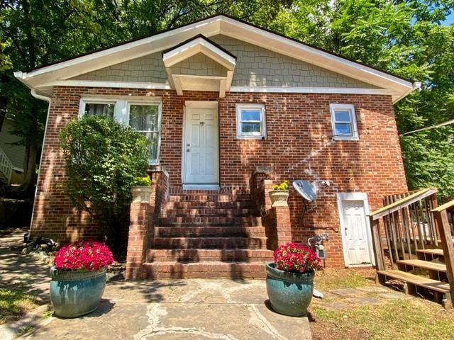 Recent price improvement!  Sellers are motivated! Charming North Chattanooga home that is walking distance to Normal Park School! Features 4 bedroom 2 full baths, hardwood flooring, tile, updated kitchen cabinets, appliances, siding, stucco and off street parking spot. The master suite has two rooms, a large cedar siding walk in closet, and it's own private entrance.  Could be used to rent out as separate space.  The huge deck is perfect for entertaining.  Some improvements recently made are: newer architectural shingle roof(30 year shingle), newer energy star windows, new gutters & gutter guards, downspouts, soffits, new furnace (3 years old), newer appliances (3 years old), and updated interior.  Purchase with confidence as this home comes with a 1 year home warranty! Sellers have done some recent professional landscaping.  The backyard area is fairly large and the previous owners had a nice path to a cleared area with a fire pit. Would be a perfect area for a yard for kids to play or fenced for pets.